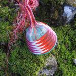Telephone wire basket on mossy rocks alongside a creek at Lemont, Tasmania.