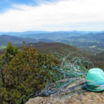 Wire basket in progress, on top of Cathedral Rock, with the Huon Valley and Adamson's Peak in the distance.