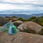 Telephone-wire basket in its mould, on rocks on Mt Wellinton, overlooking South Arm and the Derwent Estuary.