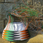 Telephone wire basket in progress with a little more than half of the sides completed.